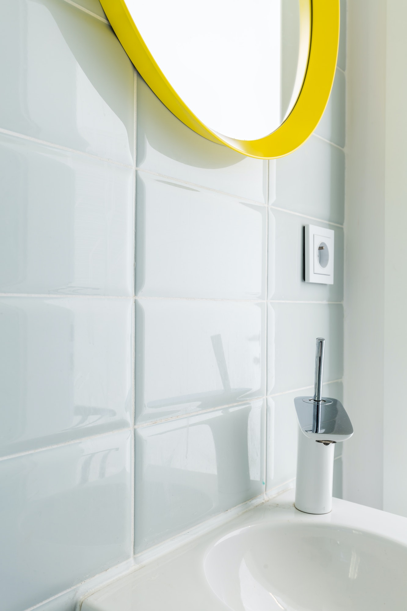 White bathroom with yellow mirror